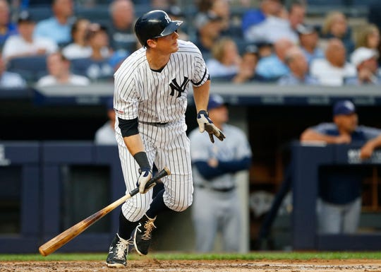 New York Yankees second baseman DJ LeMahieu (26) tosses his bat after hitting a home run against the Tampa Bay Rays in the third inning at Yankee Stadium.