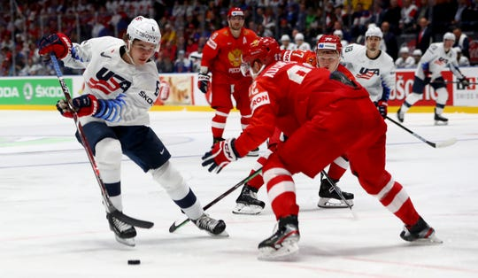 Yevgeni Kuznetsov #92 of Russia challenges Jack Hughes #6 of United States during the 2019 IIHF Ice Hockey World Championship Slovakia quarter final game between Russia and United States at Ondrej Nepela Arena on May 23, 2019 in Bratislava, Slovakia.