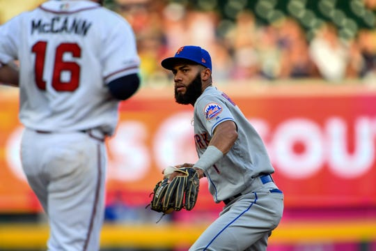 New York Mets shortstop Amed Rosario (1) forces out Atlanta Braves catcher Brian McCann (16) during the second inning at SunTrust Park.