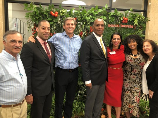 Todd Lachman, the President and CEO of Sovos brands, with Montclair officials at the opening party for Rao's Homemade. From left, Councilmen Bob Russo and Sean Spiller, Lachman, Mayor Robert Jackson, Risa Cretella, General Manager of Rao's Homemade, and Councilwomen Renee Baskerville and Robin Schlager.