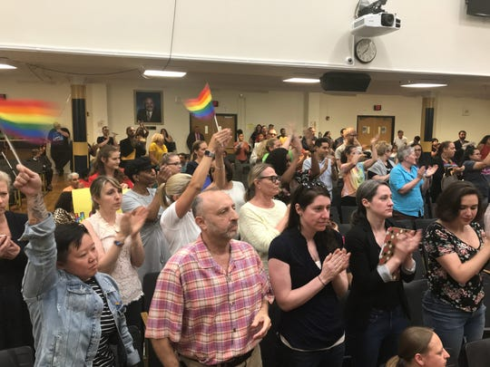 Supporters of the LGBT community give a standing ovation to acting Hackensack Superintendent Rosemary Marks after she delivers a pro-LGBT message at the June 17, 2019 school board meeting.