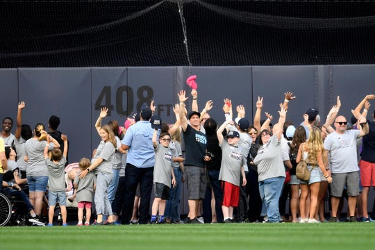 HOPE Week alumni are honored prior to a baseball game between the New York Yankees and the Tampa Bay Rays, Monday, June 17, 2019, in New York. (AP Photo/Sarah Stier)