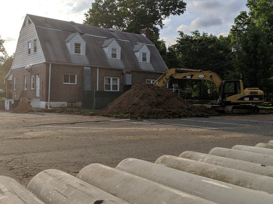 Site work has begun at the American Legion building, which will become a parking lot for a new River Edge Community Center.