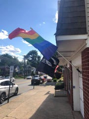 The rainbow LGBTQ Pride flag placed in front of Dumont's Borough Hall was taken down by an individual on June 15 and June 17, but was back up again as of June 18.