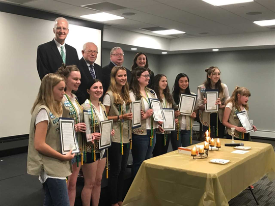 Wyckoff Committee member Brian Scanlan, Rudy Boonstra, Mayor Thomas Madigan and Committeewoman Melissa Rubenstein congratulate nine Gold Award Girl Scouts Monday.