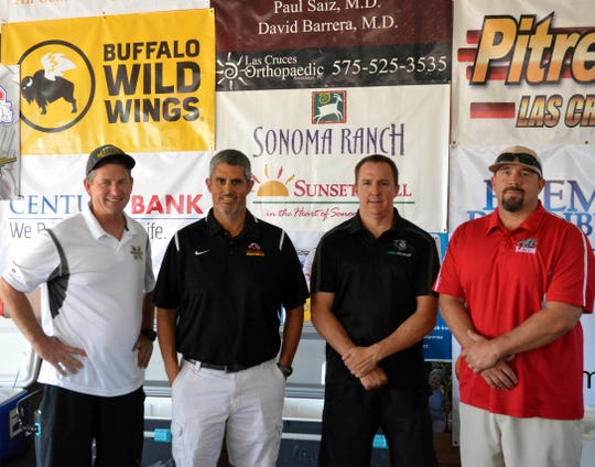 The third annual 12th Man Golf Tournament raised nearly $95,000 to be divided by the the four Las Cruces Public Schools football booster clubs. Football coaches, from left: Michael Bradley, Aaron Ocampo, Centennial High; Stephen Castille, Oñate High and Mark Lopez, Las Cruces High.