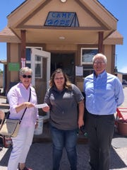 From left to right, Patti Risk (Trinity Lutheran), Lacey (Community of Hope), and Pastor Wayne Nieminen (Trinity Lutheran), stand with a cash gift of $1,281 to the Mesilla Valley Community of Hope May 28.
