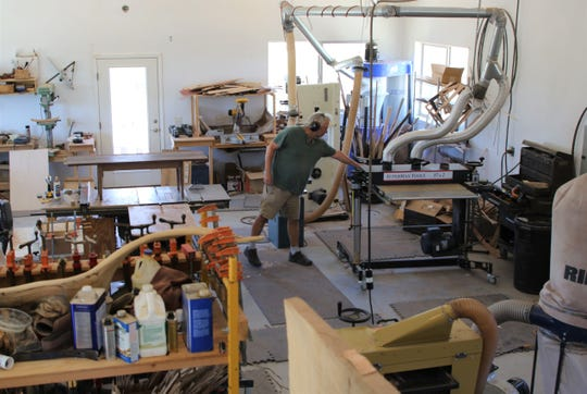 Artist Steven Barr checks on a piece of equipment in his studio north of Aztec on June 18.