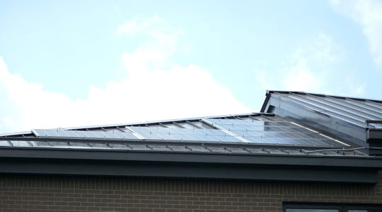 Solar power panels lie atop the home on East Lincoln in Birmingham.