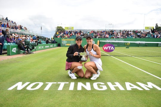 Desirae Krawczyk, left, celebrates her second doubles title with Giuliana Olmos in Nottingham, England.