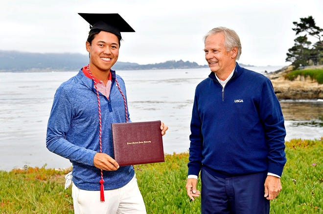 Jun 16, 2019; Pebble Beach, CA, USA; Brandon Wu receives his college diploma from Stanford after completing the final round of the 2019 U.S. Open golf tournament at Pebble Beach Golf Links