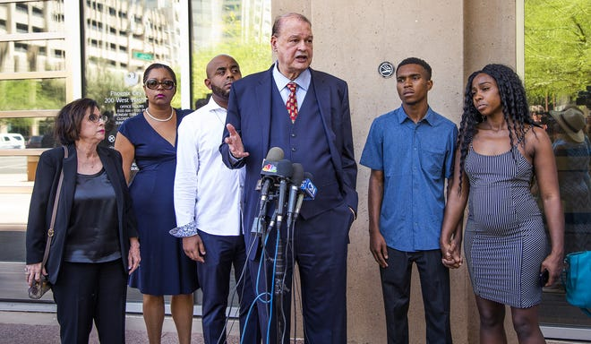 The couple who had a run-in with Phoenix police on May 27, 2019, have filed a $10 million lawsuit against the city of Phoenix.  At a press conference on June 17 outside City Hall discussing the incident and the lawsuit are former Arizona Attorney General Tom Horne (middle) and Dravon Ames, 22, and his fiancee Iesha Harper, 24.