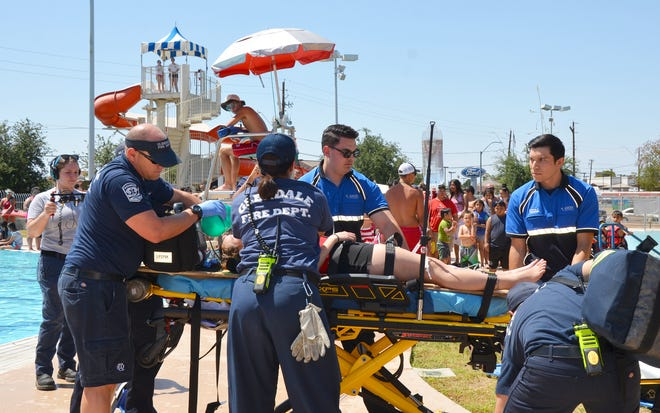 Glendale firefighters conduct a mock drowning to demonstrate the importance of water safety.