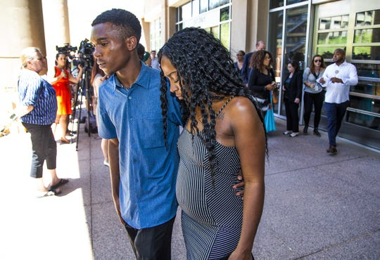 After a press conference outside City Hall on June 17, Dravon Ames, 22, and his fiance Iesha Harper, 24, leave.