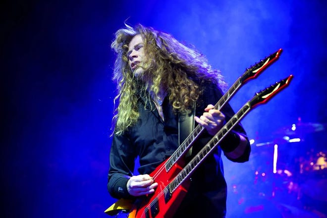 In a Friday, April 8, 2011, file photo, singer and guitarist Dave Mustaine of the American metal band Megadeth performs during their concert in the Budapest Sports Arena in Budapest, Hungary. Megadeth's Dave Mustaine announced on social media Monday, June 17, 2019, that he had been diagnosed with throat cancer.