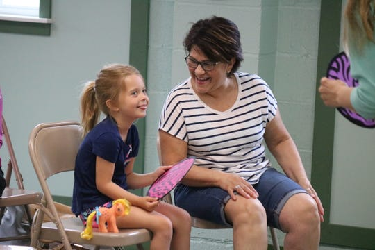 Gianna Bolte, 5, and Celia Chandler sing and dance along during the Nature Story Time at Portage Township on Tuesday.