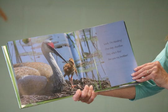 Terri Winke, preschool coordinator at Ida Rupp Public Library, reads a wildlife-themed children's book for the Nature Story Time in Portage Township on Tuesday.