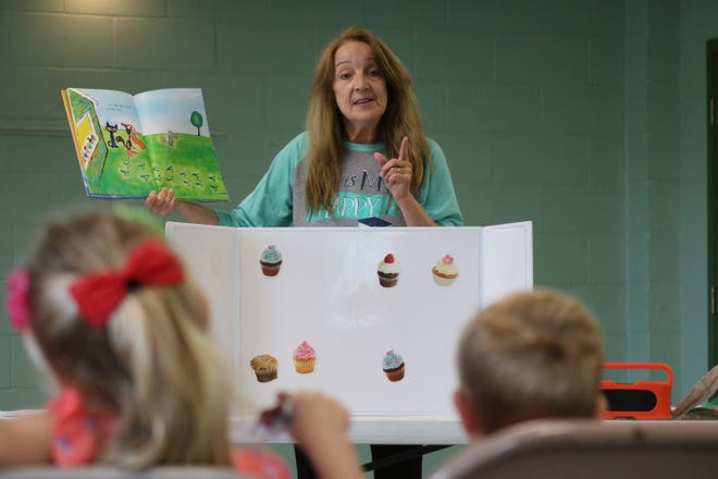 "Terri Winke, preschool coordinator at Ida Rupp Public Library, reads a story from ""Pete the Cat,"" a popular children's book series, during Nature Story Time in Portage Township on Tuesday."