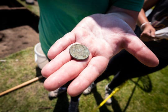 Grace Carrol shows off a penny from the 1850's that she found during an archaeological dig Tuesday, June 18, 2019 at the Fort Gratiot Lighthouse.