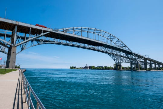 Thousands of commercial trucks have traveled through the U.S.-Canada border at the Blue Water Bridge in Port Huron since a travel ban for non-essential traffic was put in place on March 21.