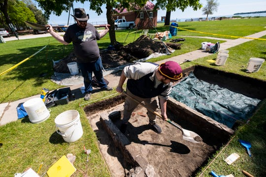 Jacob Fishel, left, watches Eli Cross dig in the foundation of a privy that was unearthed during an archaeological dig at the Fort Gratiot Lighthouse Tuesday, June 18, 2019.