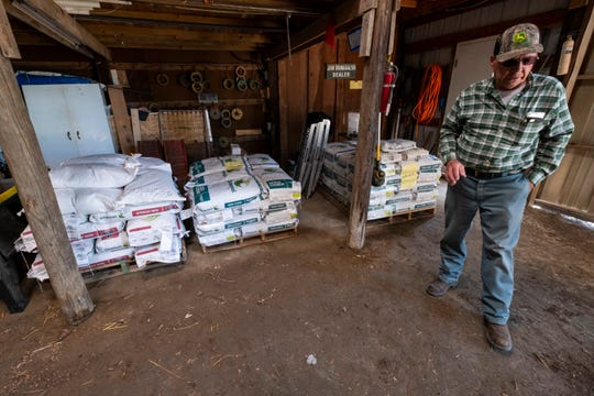 Jim Domagalski stands in his barn near pallets holding bags of different seeds Tuesday, June 11, 2019. Because of wet conditions, Domagalski has been delayed in planting his crops, and now says it may be too late in the year.