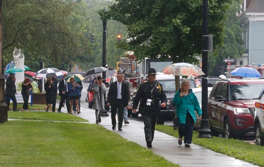 Mourners return to their vehicles following the funeral mass for Tim McCormack at St. Mary's Church in Poughkeepsie on June 18, 2019.