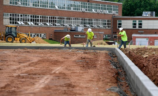 An $8 million expansion and renovation project at York Catholic High school includes a new artificial turf sports field, a retention pond, remodeled classrooms and an elevator, Tuesday, June 18, 2019.