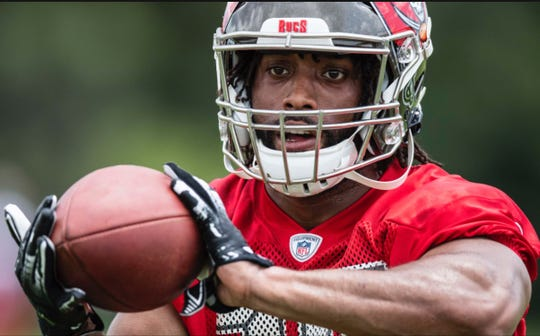 York Catholic graduate Hakeem Kinard practices with the Tampa Bay Buccaneers during the team's rookie minicamp in May.
