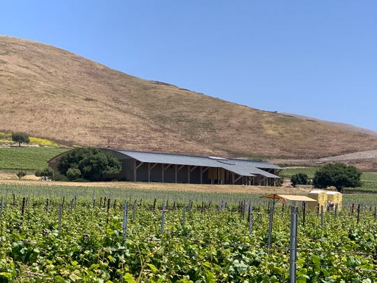Byron Winery, with its signature neo-rustic sloping roof, rises among its Santa Maria Valley, Calif., vineyards. The winery is open only for by-appointment tastings.