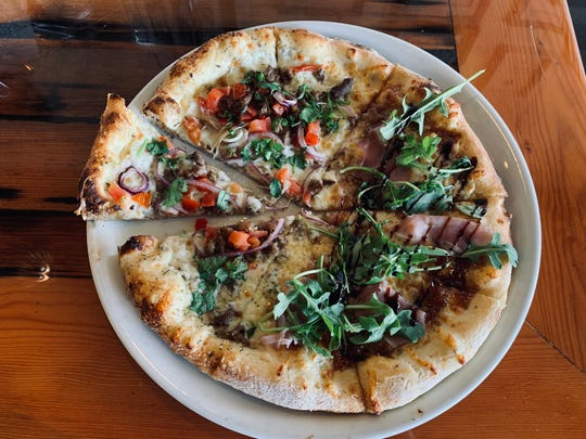 Thin-crust pies at Pizzeria Bello Forno near the Santa Maria Valley, Calif., wine country come in 9- and 12-inch sizes, including this fig jam and prosciutto specimen.