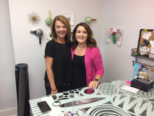 Kim Hoppe, left, and Lori Dickerson run businesses in the Embellish building. Dickerson will expand her salon to utilize all of the building's space after Hoppe closes Embellish.