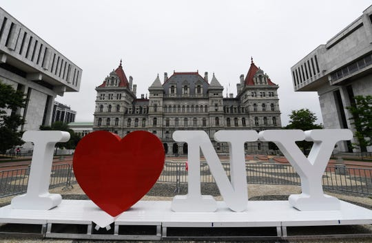 "A new promotional ""I Love NY"" sign sits in the Empire State Plaza for installation in front of the New York state Capitol Tuesday, June 18, 2019, in Albany, N.Y."