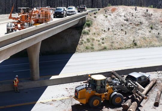 A logging truck spilled its load of logs from an overpass onto southbound Interstate 5 on Tuesday morning about 30 miles north of Redding. One log landed in the bed of a man's pickup. He was shaken up but not injured, the CHP said. Southbound freeway traffic was backed up about 6 miles at the site north of Lakehead.