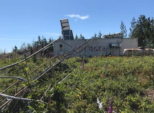 A communication tower on the Oregon coast was destroyed Monday after the guy wires were cut.