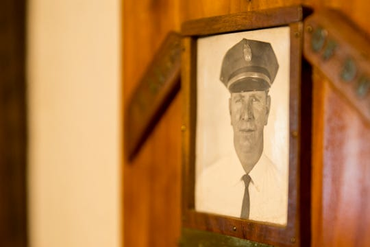 A photo of Lt. Robert C. Geer, one of 11 corrections employees killed in the line of duty and the last to be slain at the penitentiary in 1972, hangs on the wall at Randy Geer's home in Salem on May 22, 2019.