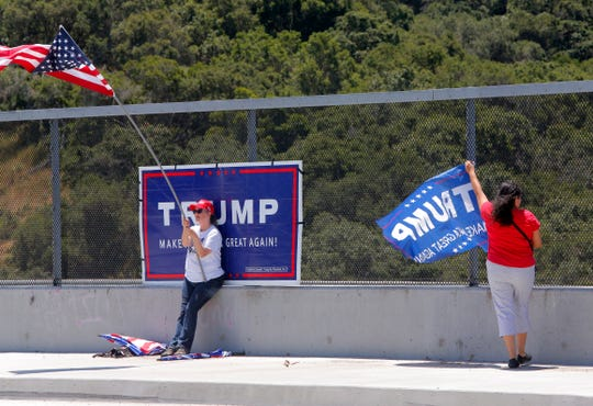 Lisa King, of Salinas, and Anitra Mireles, 44, of Prunedale, joined a crowd of about a dozen Tuesday on Crazy Horse Road's overcrossing on Highway 101. They were rallying to support President Donald Trump's re-election bid.