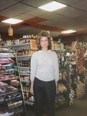 Owner Joan Karter stands inside J&B Subs in this photograph taken in the 1980s.