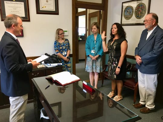 Tonya Lewis (center) was sworn into the Wicomico County Board of Education on Tuesday, June 18, 2019. She will represent District 3. Courtesy of Tracy Sahler.