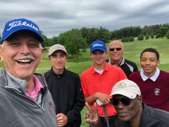 Jack Aschenbach, Nick Farraye, Yuriy Dekalskyy, Alexander Lymus with Douglas Lymus in front and Bruce Zimmerman behind practice stop for a selfie as part of their golf trip to Sheboyan this week.