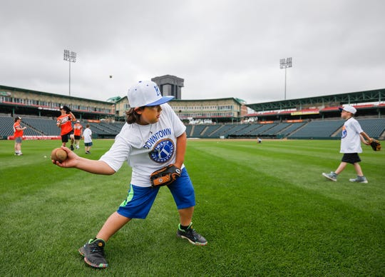 Jonathan Hawkins, 10, throws a ground ball during a fielding drill at the 4th Annual Downtown Kiwanis Baseball and Softball Camp for the Boys & Girls Clubs at Hammons Field on Tuesday.