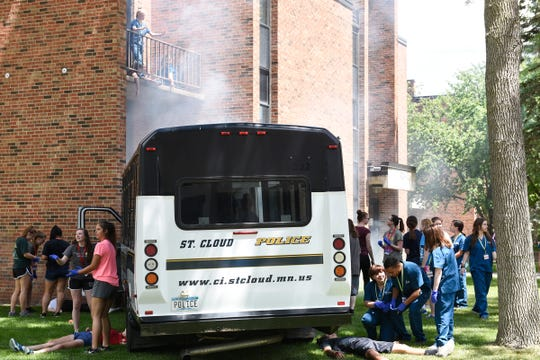 The Scrubs Camp at St. Cloud State stages a bus crash outside North Benton Resident Hall, Tuesday, June 18. Local law enforcement, the St. Cloud Fire Department and EMT's all help the children in disaster preparation and response.