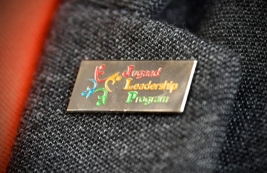A pin is worn by members of the Jugaad Leadership Program on Friday, June 14, in St. Cloud.