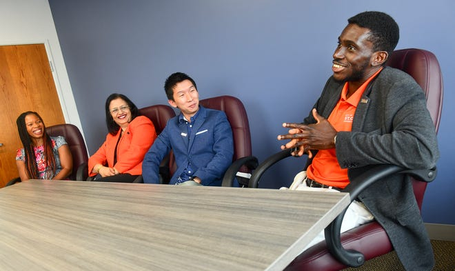 Members of the Jugaad Leadership Program advisory board, from left, Eunice Adjei, Sangeetha Jha,  Jonathan Wong and Emmanuel Oppong, talk about the mentoring program Friday, June 14, in St. Cloud.