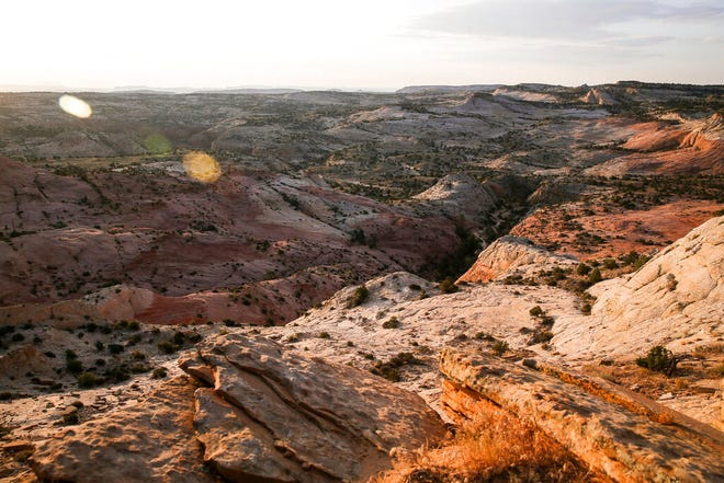 FILE - This July 9, 2017 file photo, shows a view of Grand Staircase-Escalante National Monument in Utah. A government watchdog will investigate whether the U.S. Interior Department broke the law by making plans to open up lands cut from the Utah national monument by President Trump to leasing for oil, gas and coal development. U.S. Sen. Tom Udall of New Mexico said Monday, June 17, 2019, in a news release that the Government Accountability Office informed his office last week that it has agreed to his request that it look into whether the Interior violated the appropriations law by using funds to assess potential resource extraction in the lands cut from the Grand Staircase-Escalante National Monument. (Spenser Heaps/The Deseret News via AP, File)