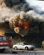 Smoke billows out of a building on Iola's Main Street during the Father's Day Fire of 1999