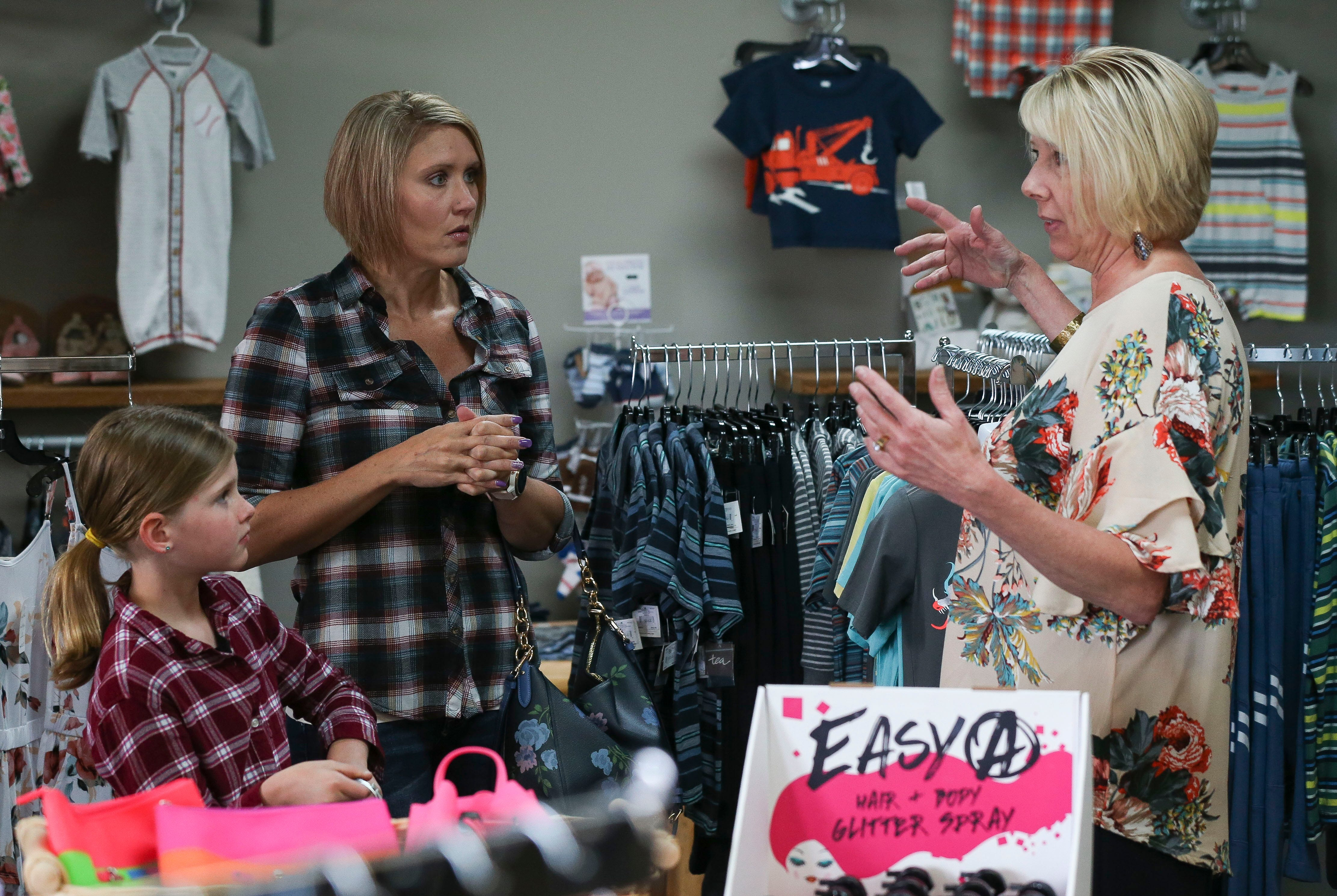 Jodi Parmeter, right, assists customers Camilla Spranger (right), 9, and her mother, Shelly Spranger, on Wednesday, June 12, 2019, at Rustic Redefined in Wisconsin Rapids, Wis. Parmeter opened Rustic Redefined in 2016 and takes pride in building strong relationships with her customers.