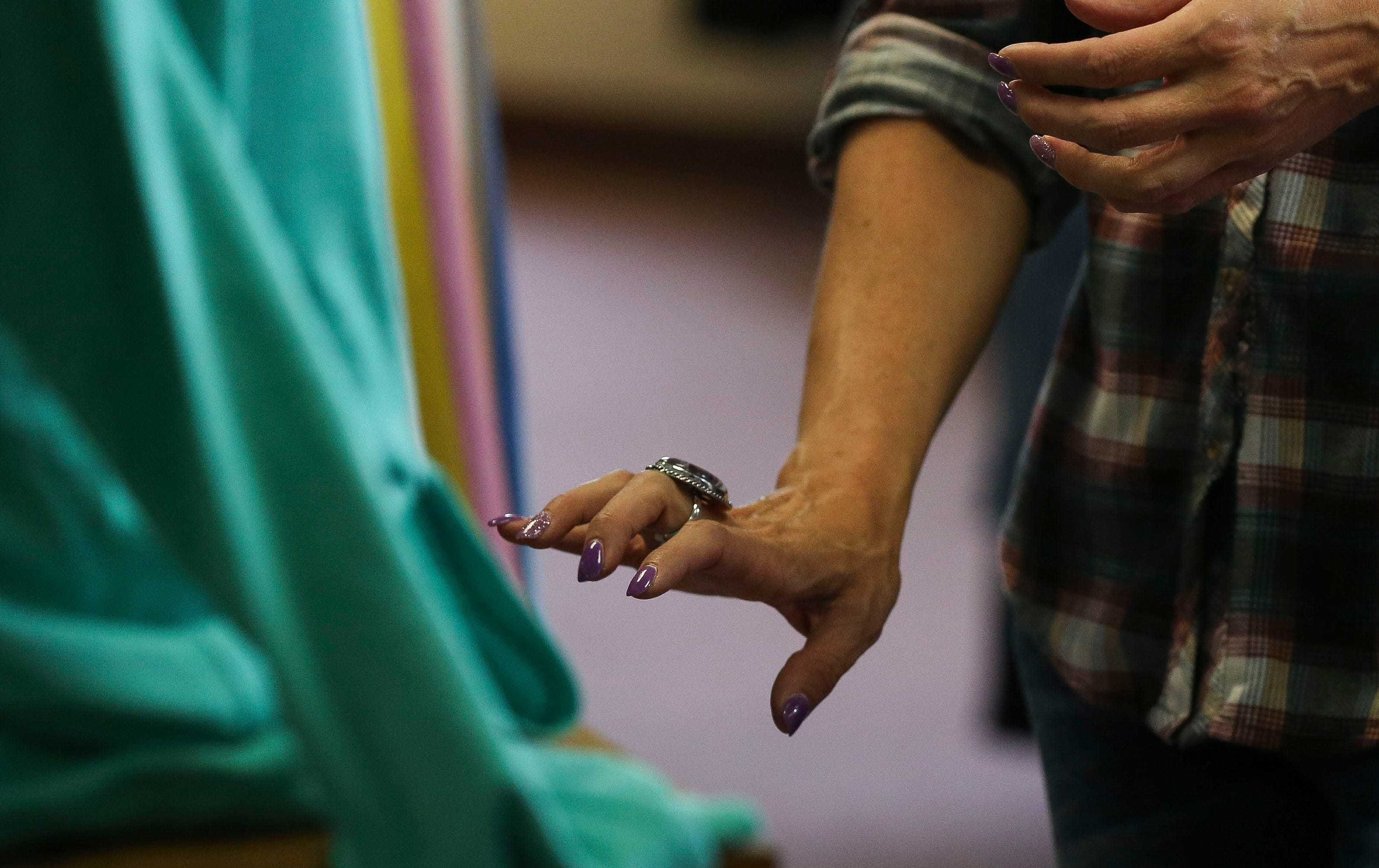 Shelly Spranger tries on a ring on Wednesday, June 12, 2019, at Rustic Redefined in Wisconsin Rapids, Wis.