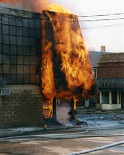 Flames climb a building during the Iola Father's Day Fire of 1999.