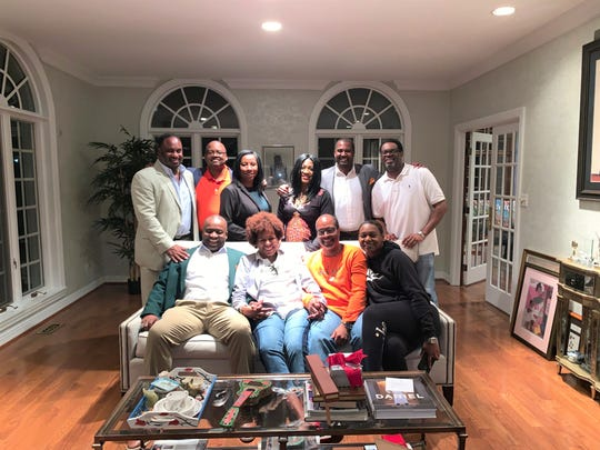 "An intimate gathering at the home of FAMU alum Cheryl Harris in Chicago on the ""Willenium Tour."" From left to right (back row): Jonathan Jackson, William Hudson, Regina Gardner, Carmen Cummings, Willie Simmons and Courtney Harris. Front row: Col. Greg Clark, Cheryl Harris, Brian Booker and Chevelle Rowe"